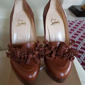 Louboutin tassel heels